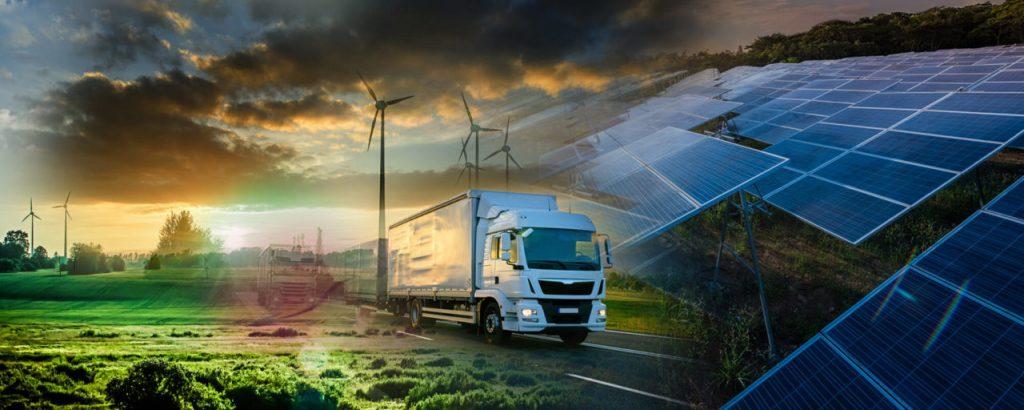 Bild med lastbilar, vindkraftverk och solenergi.